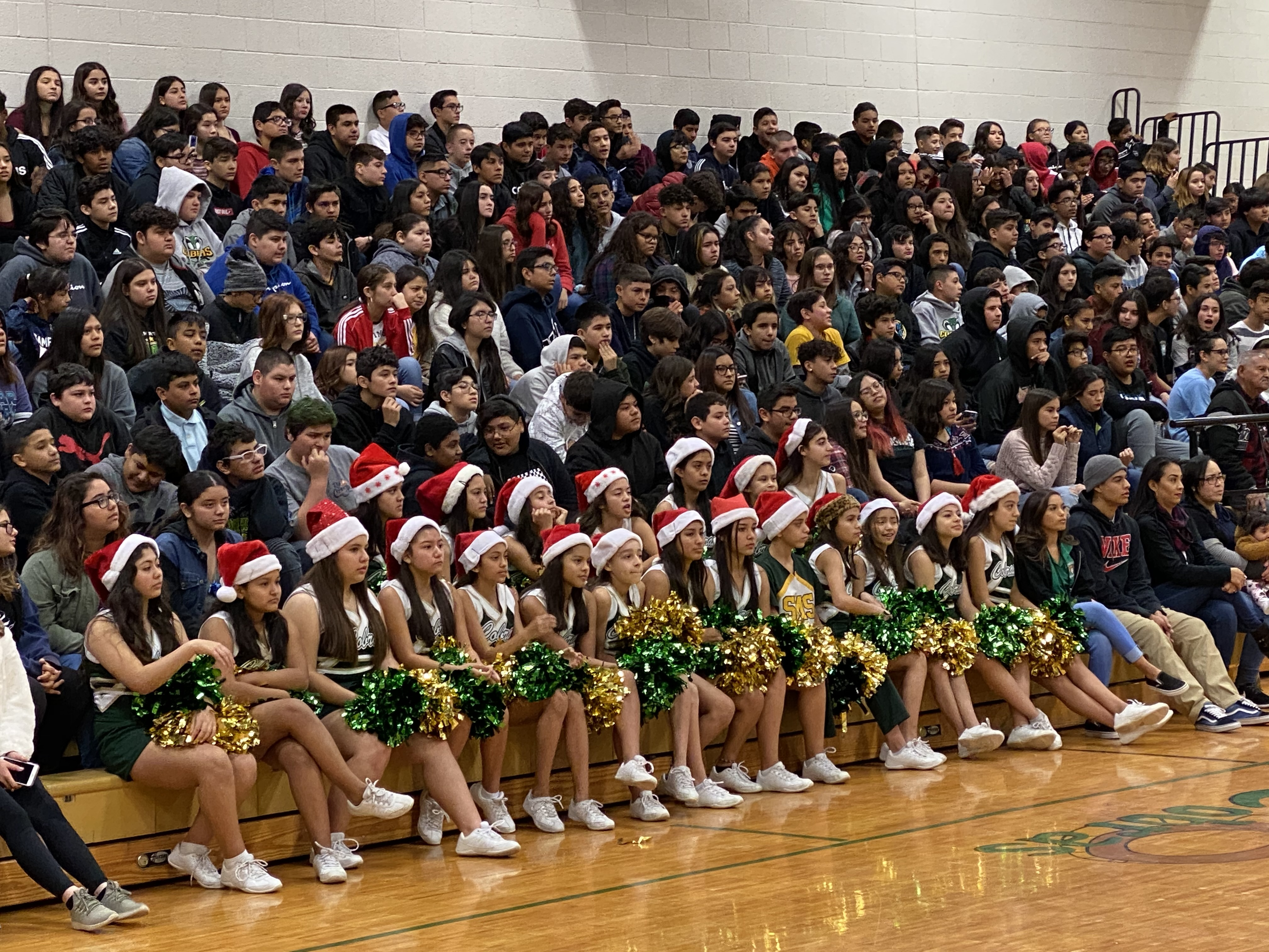 Cheerleaders and students at the winter assembly