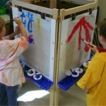 picture of kids in their classroom painting