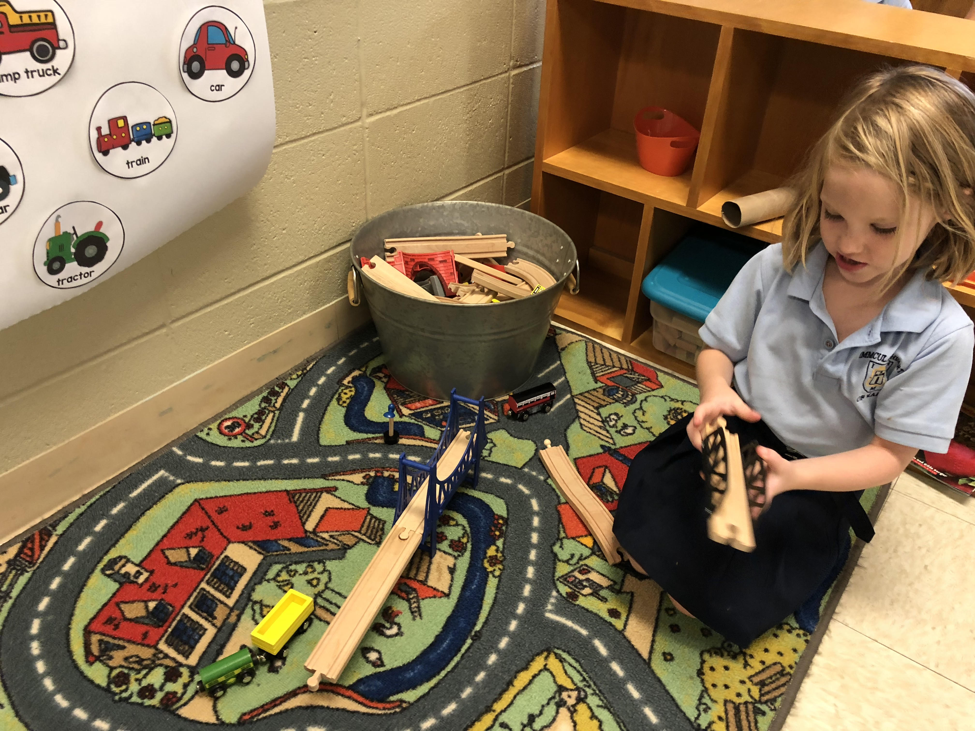 Photo of a girl playing with a construction set