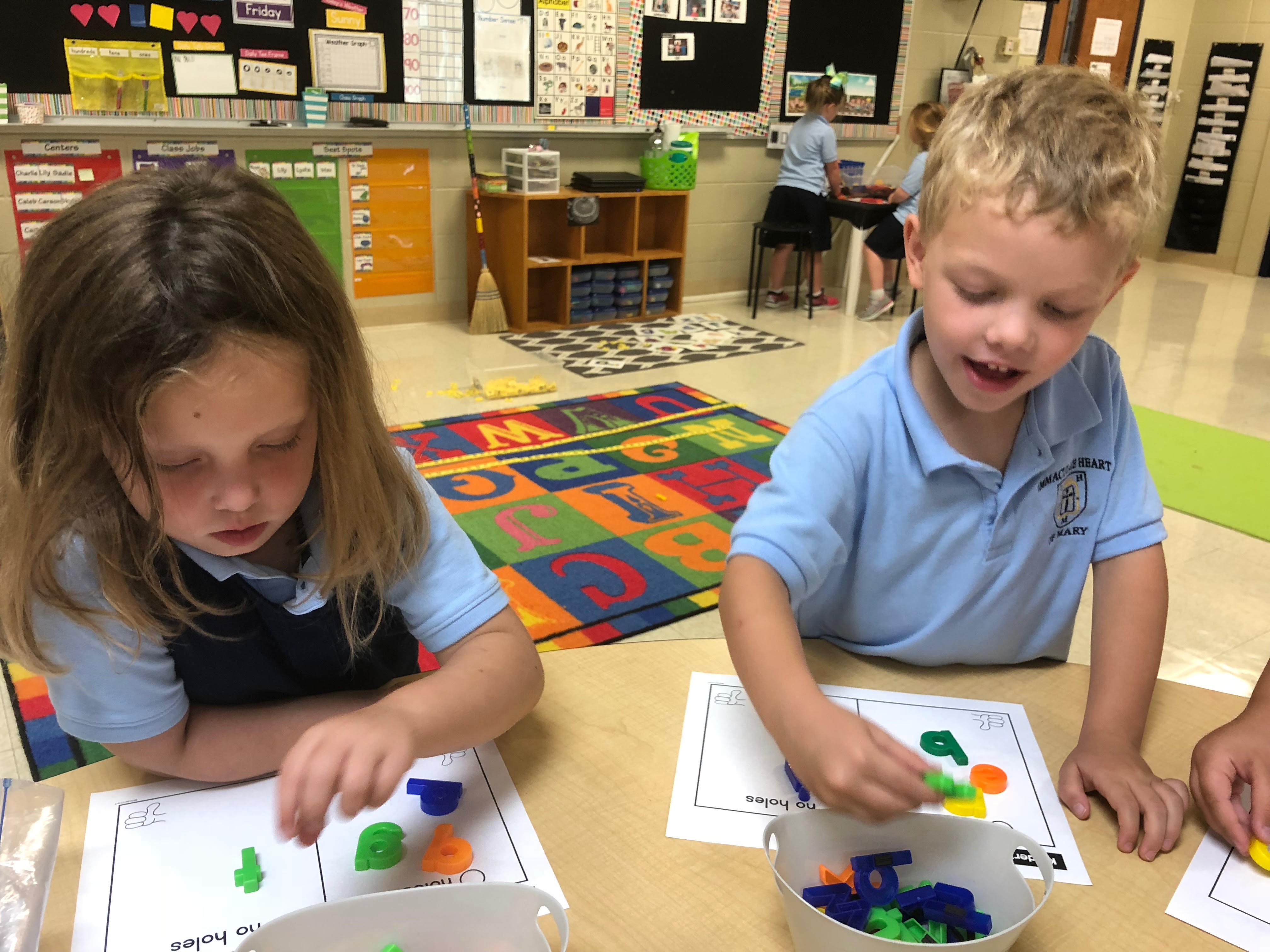 Kids playing with magnetic letters