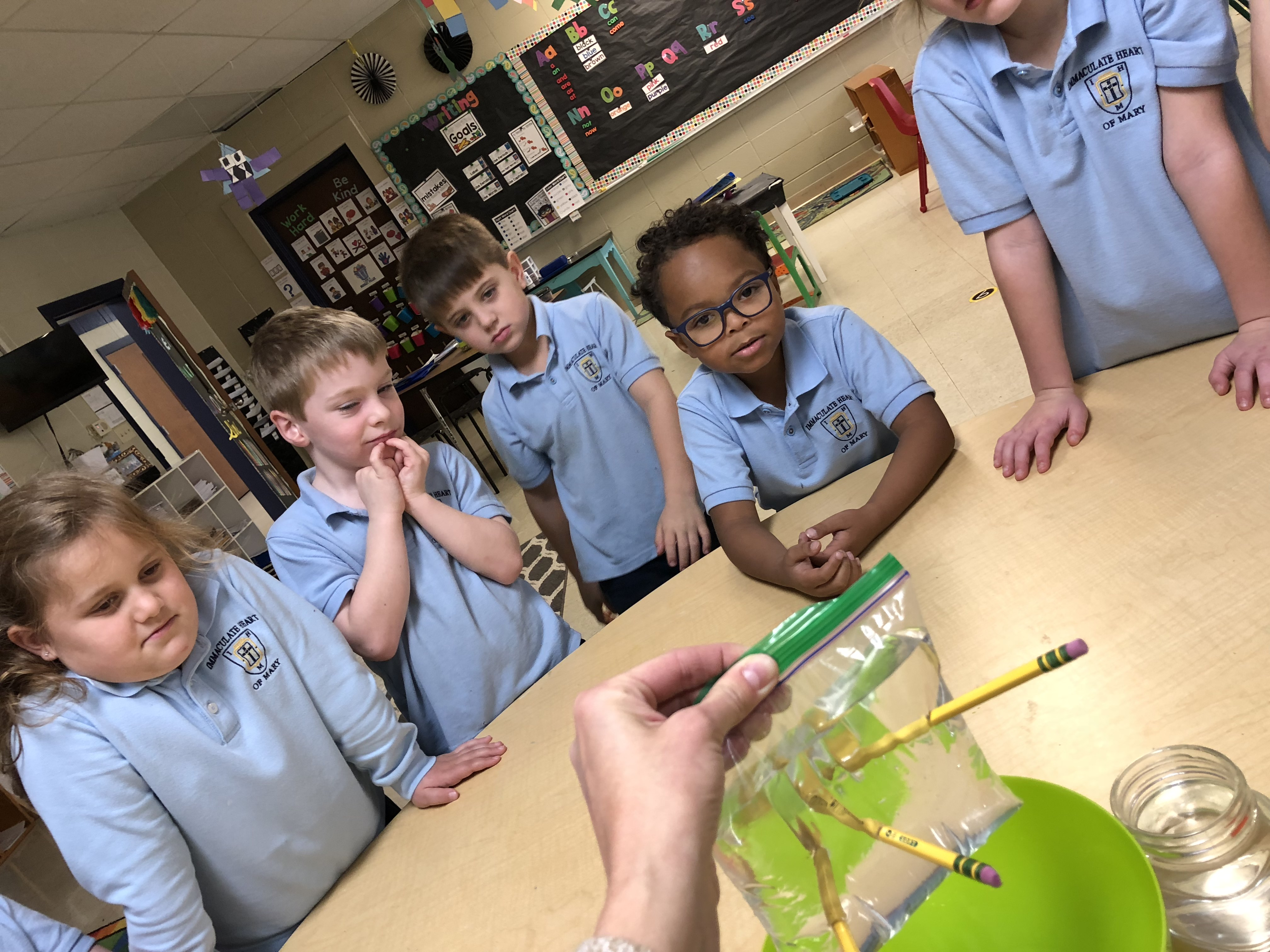 Kids doing an experiment with their teacher