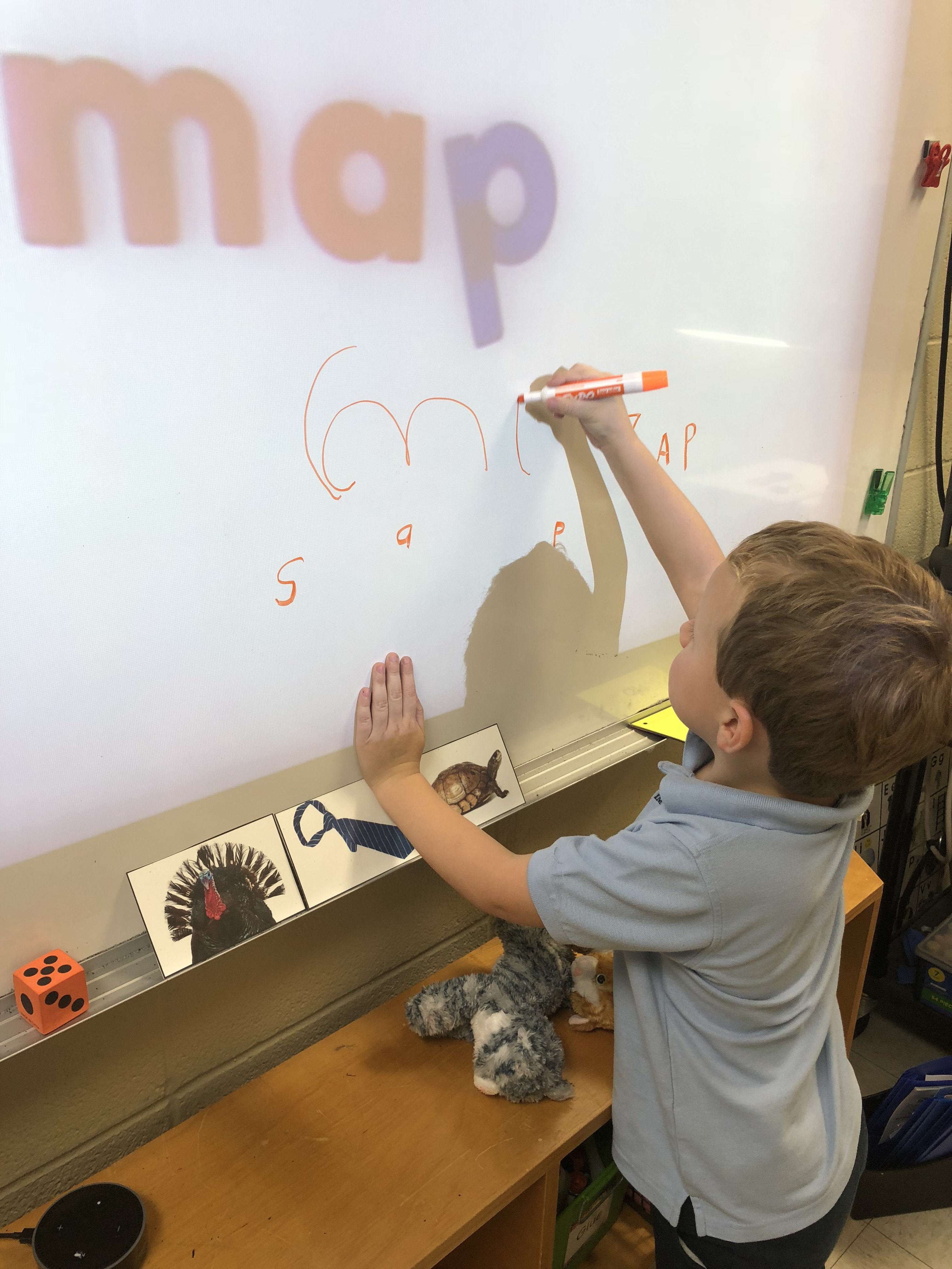 A little kid doing writing excersices