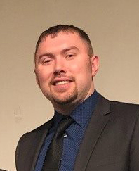 Photo of the School's District Superintendent, Lucas Holloway