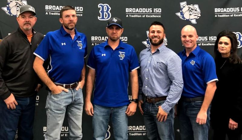 Five school board members pose in front of Broaddus ISD background