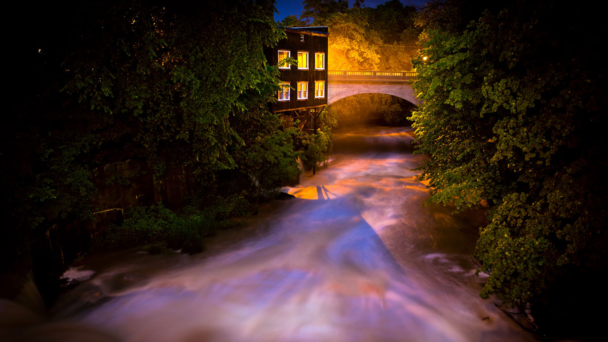 Eagle Creek flows past the historic watermill as it passes beneath the Windham Street Bridge