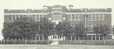 An old picture of the front of the school