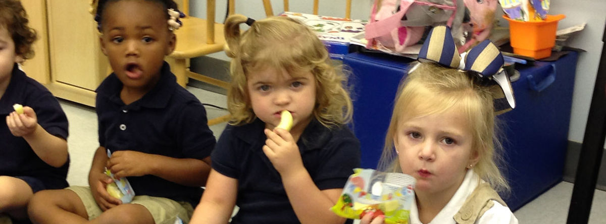 Four students eating snacks