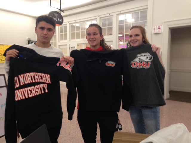 picture of foreign exchange students holding t-shirts