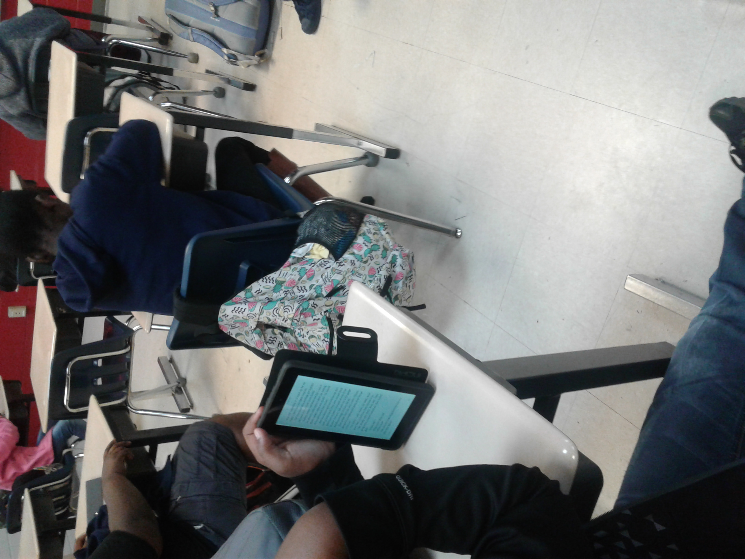 Photo of student using technology at class.