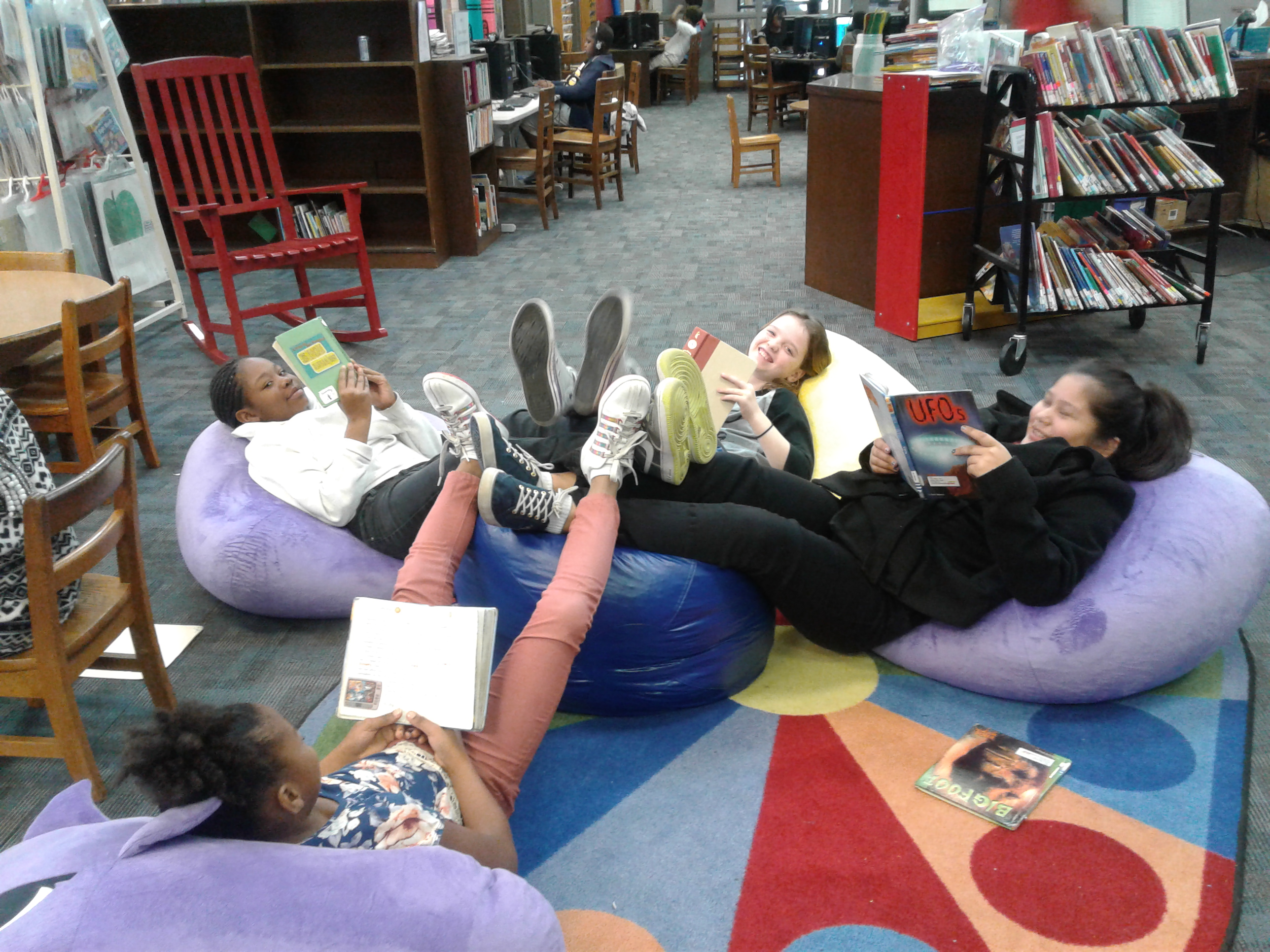 Photo of students reading in the library.