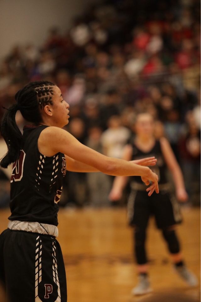 A photo of a the girls basketball team playing.