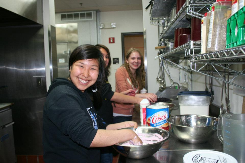 A photo of some student cooking.