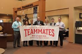 Teammates holding banner