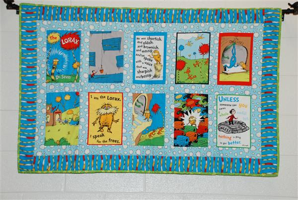 A board with book covers recommending them to the students.