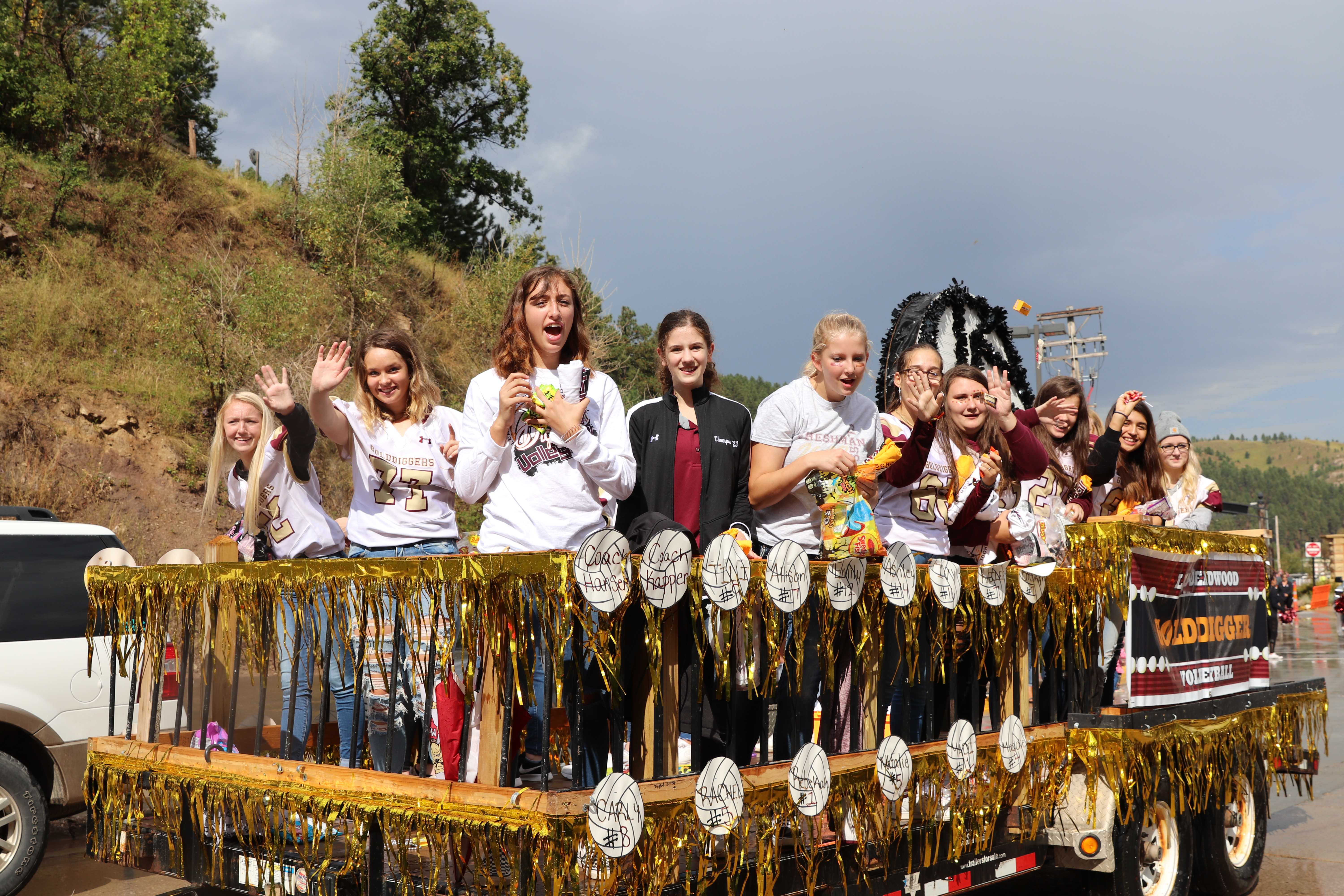 A photo of the girls Volleyball team in a parade.