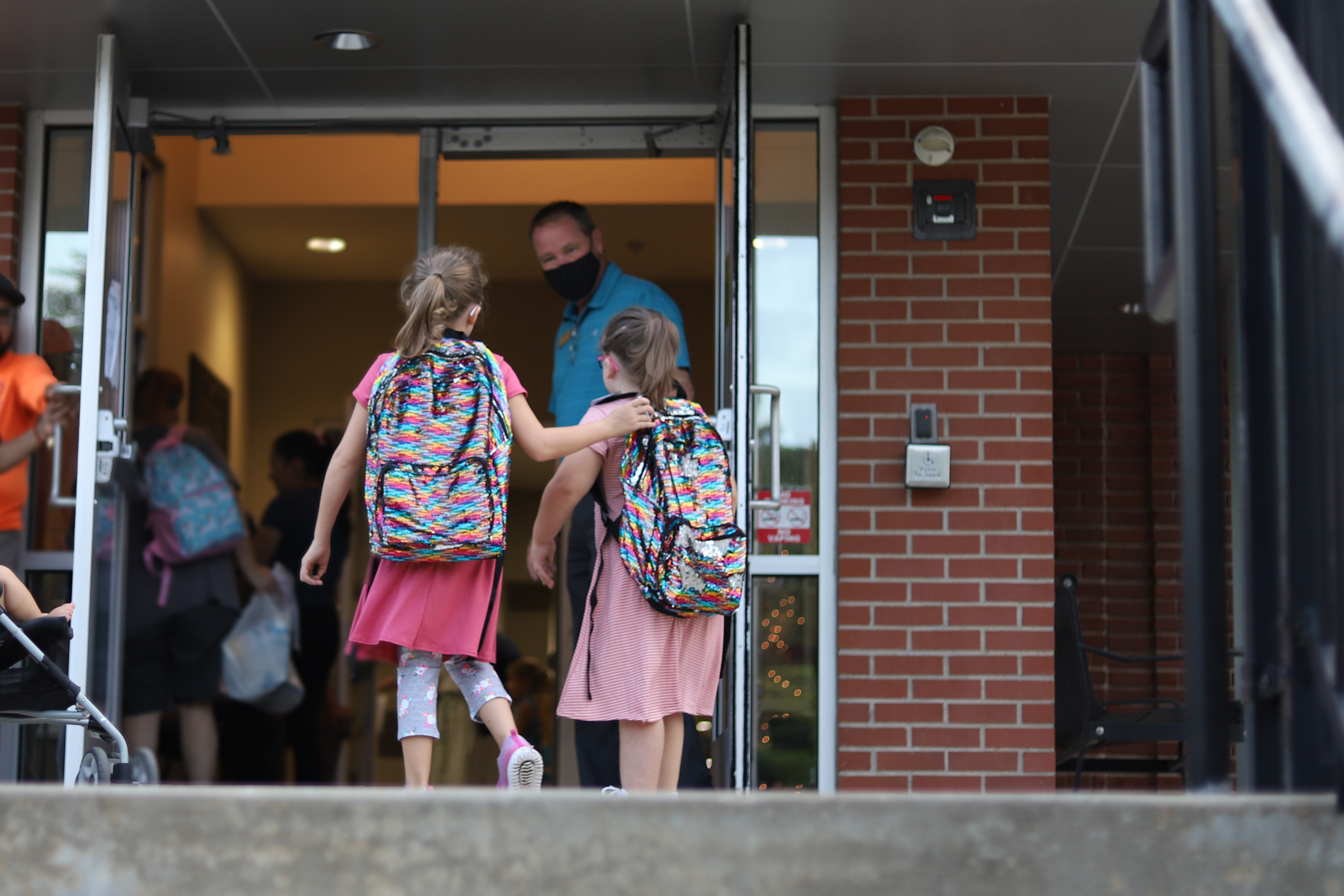 Two students walking into Garfield STEAM Academy