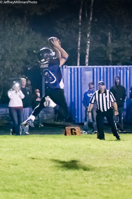 jumping to catch football