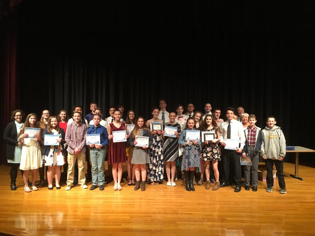 students holding awards