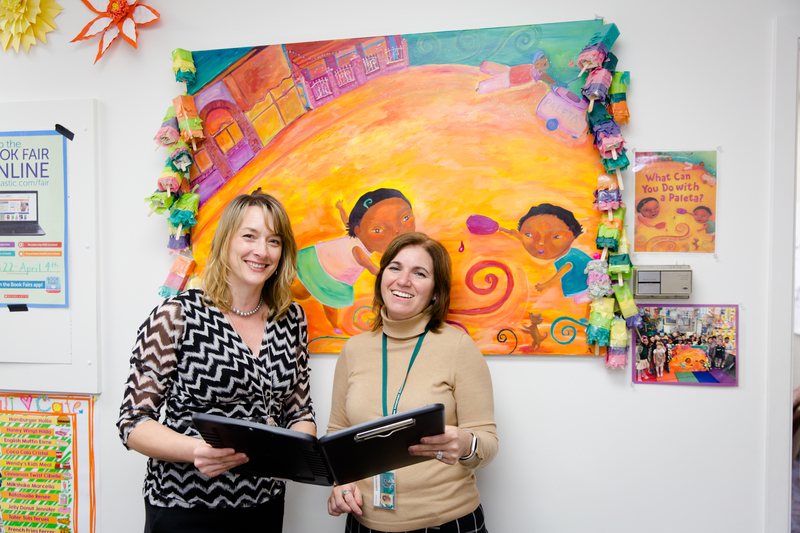 A photo of two staff members.