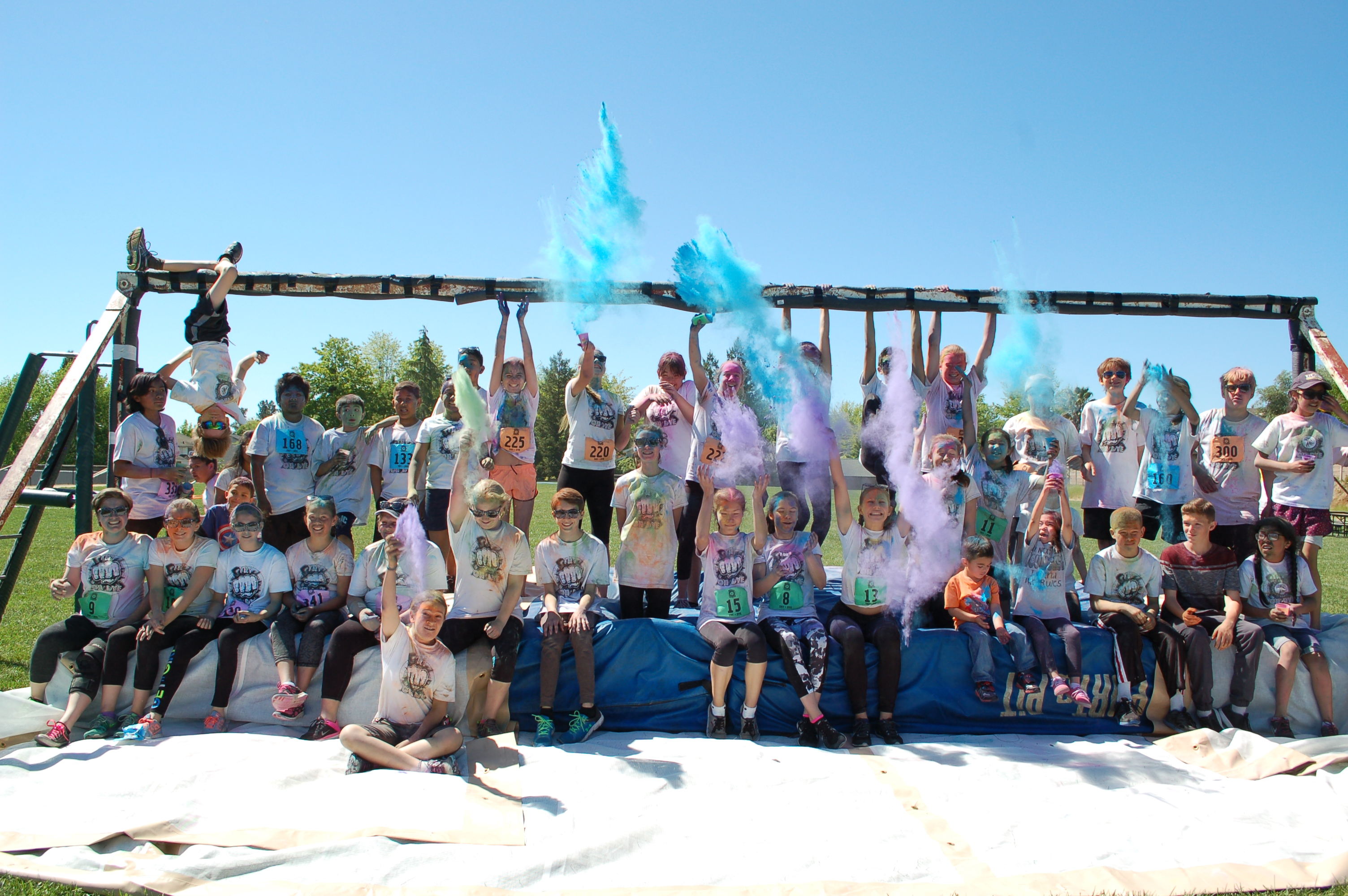 A photo of some students and staff playing with color powders.