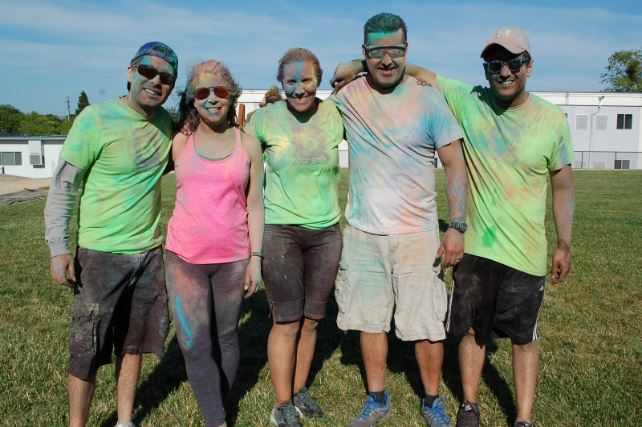 A photo of the district staff cover with color powders.