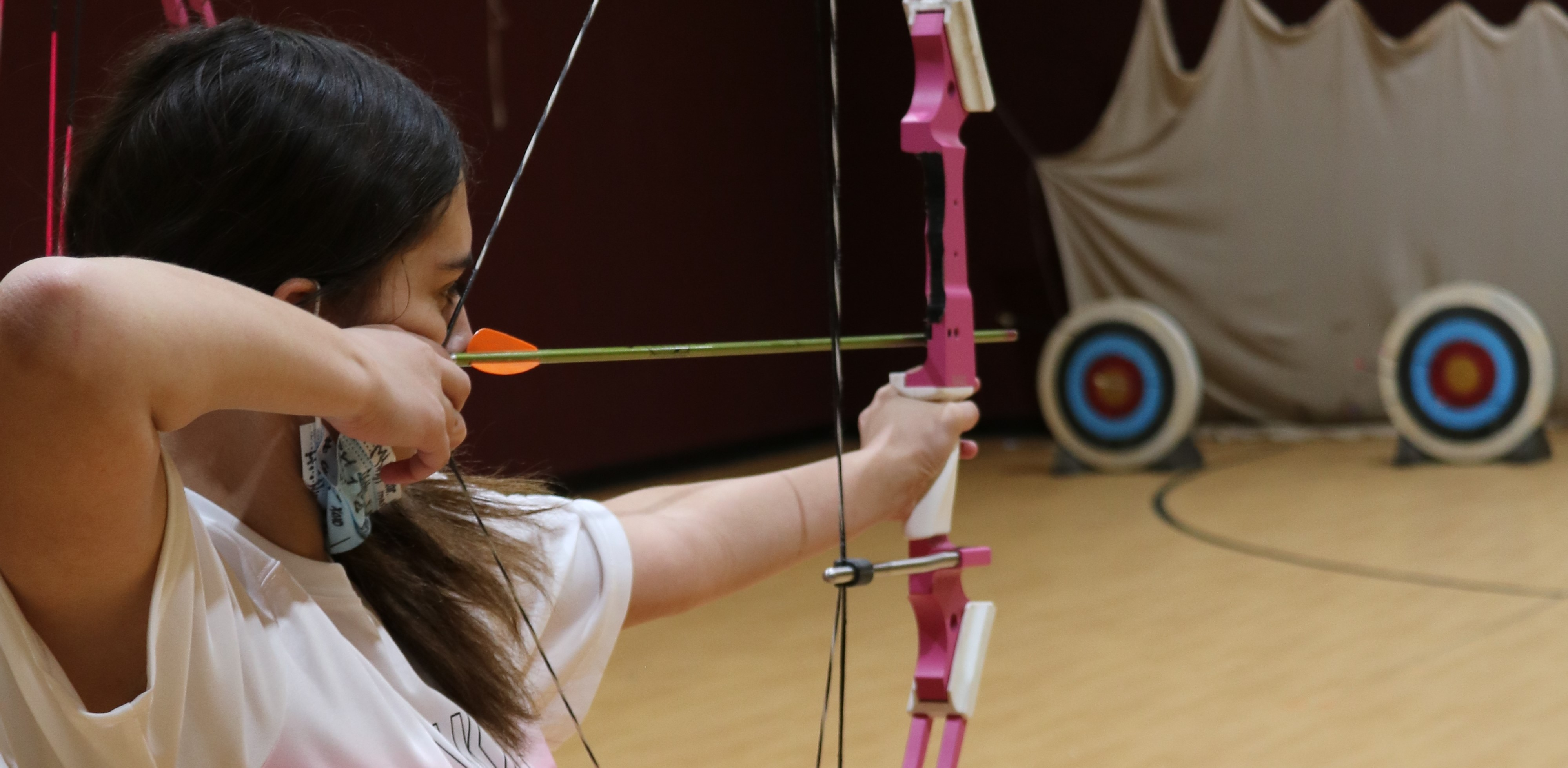 Archery Student Preparing to Shoot at Target