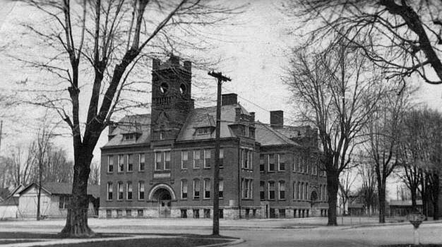 A black and white photo of a bigger school, constructed around 1896.