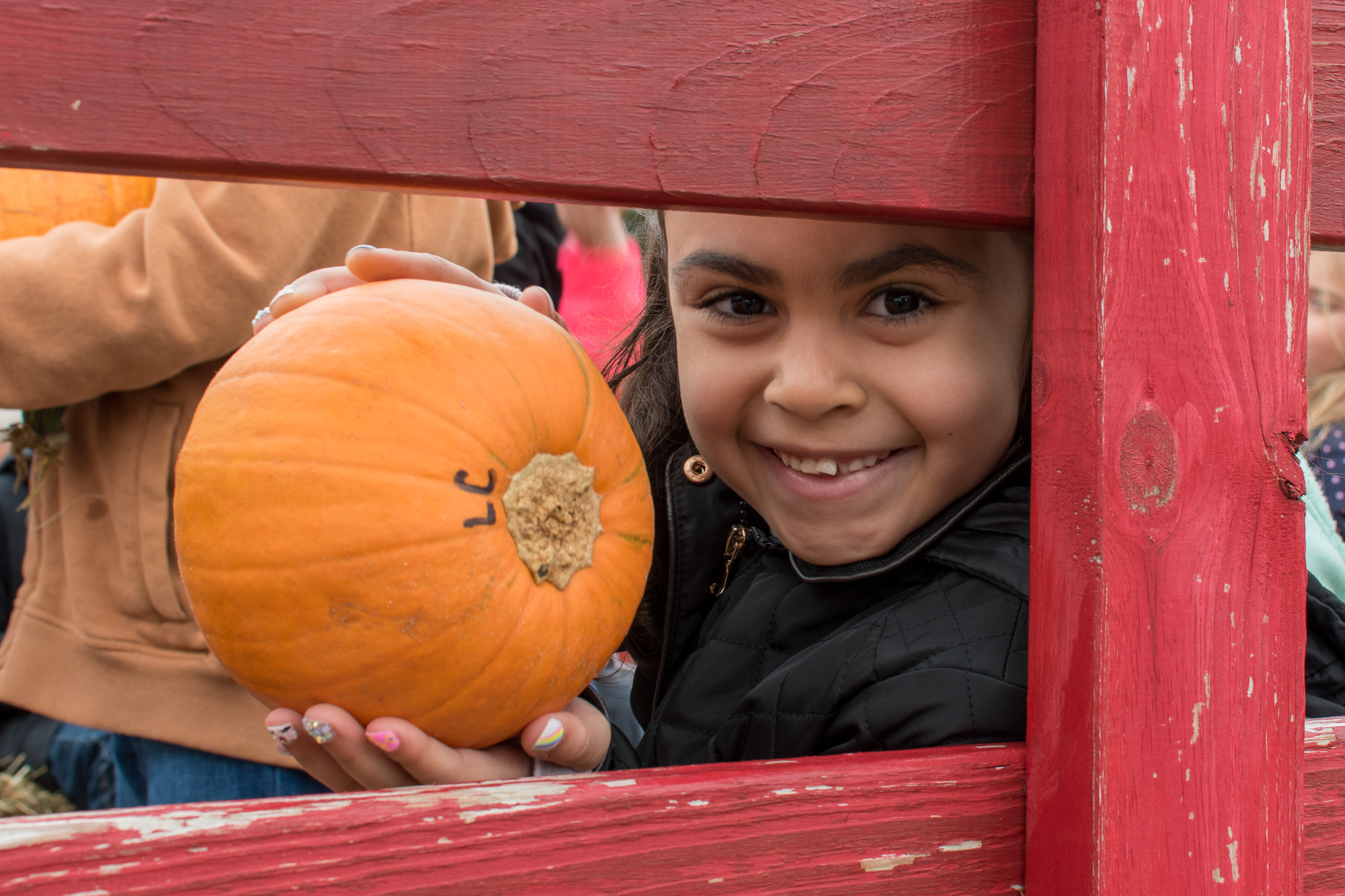 Young girl with a pumpkin