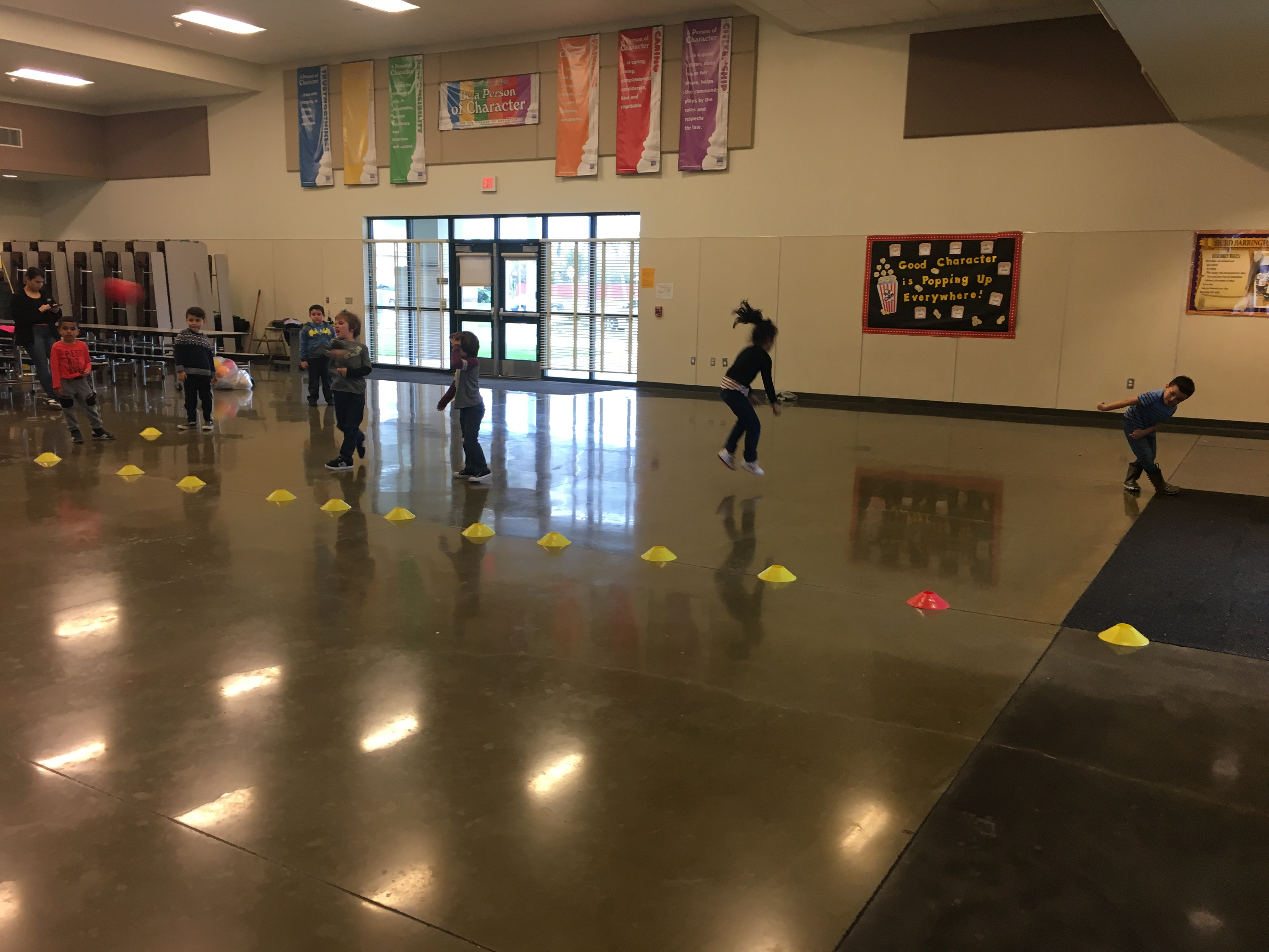 A group of students playing dodgeball