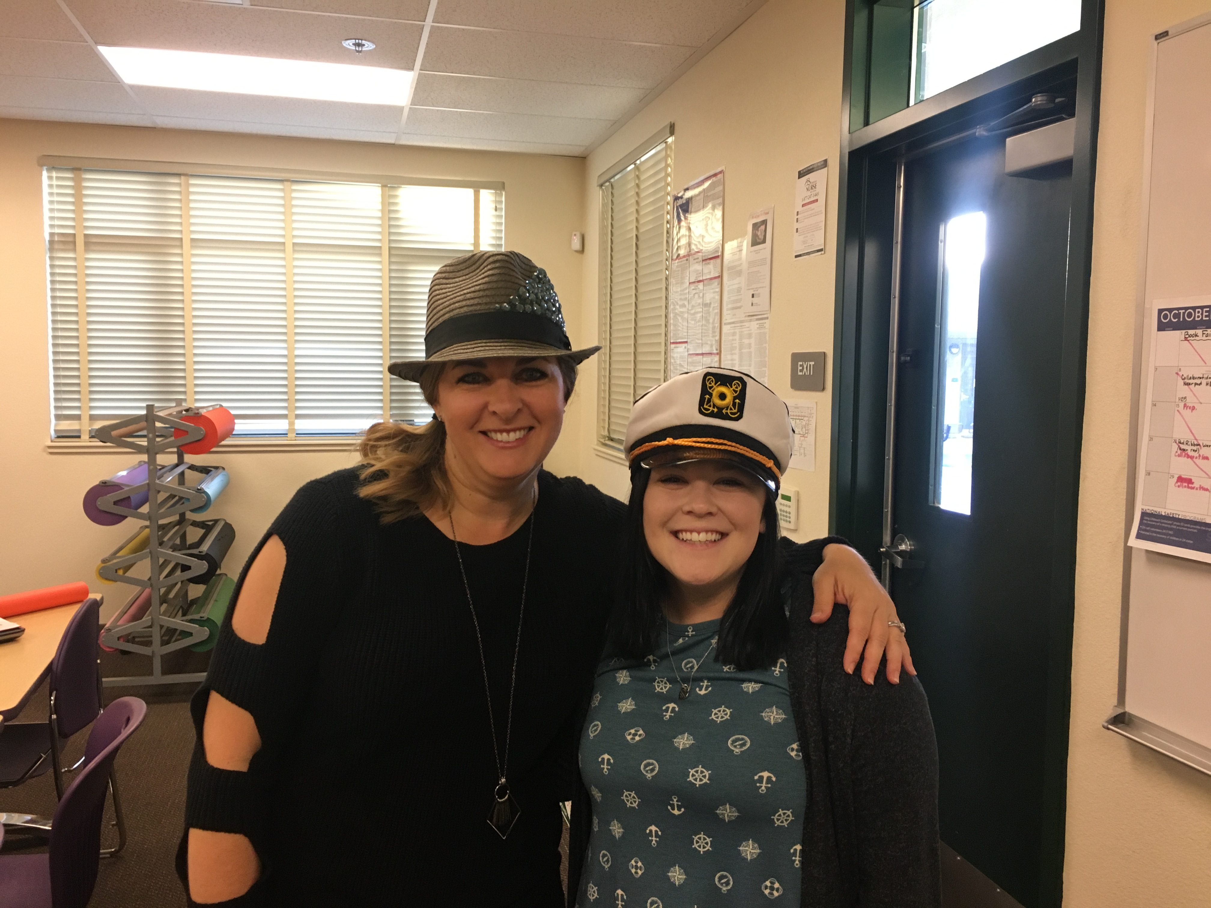 Students and teachers alike wearing different hats and caps