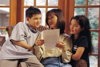 A stock photo of a mother and her two children