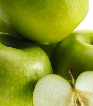 A photo of many green apples.