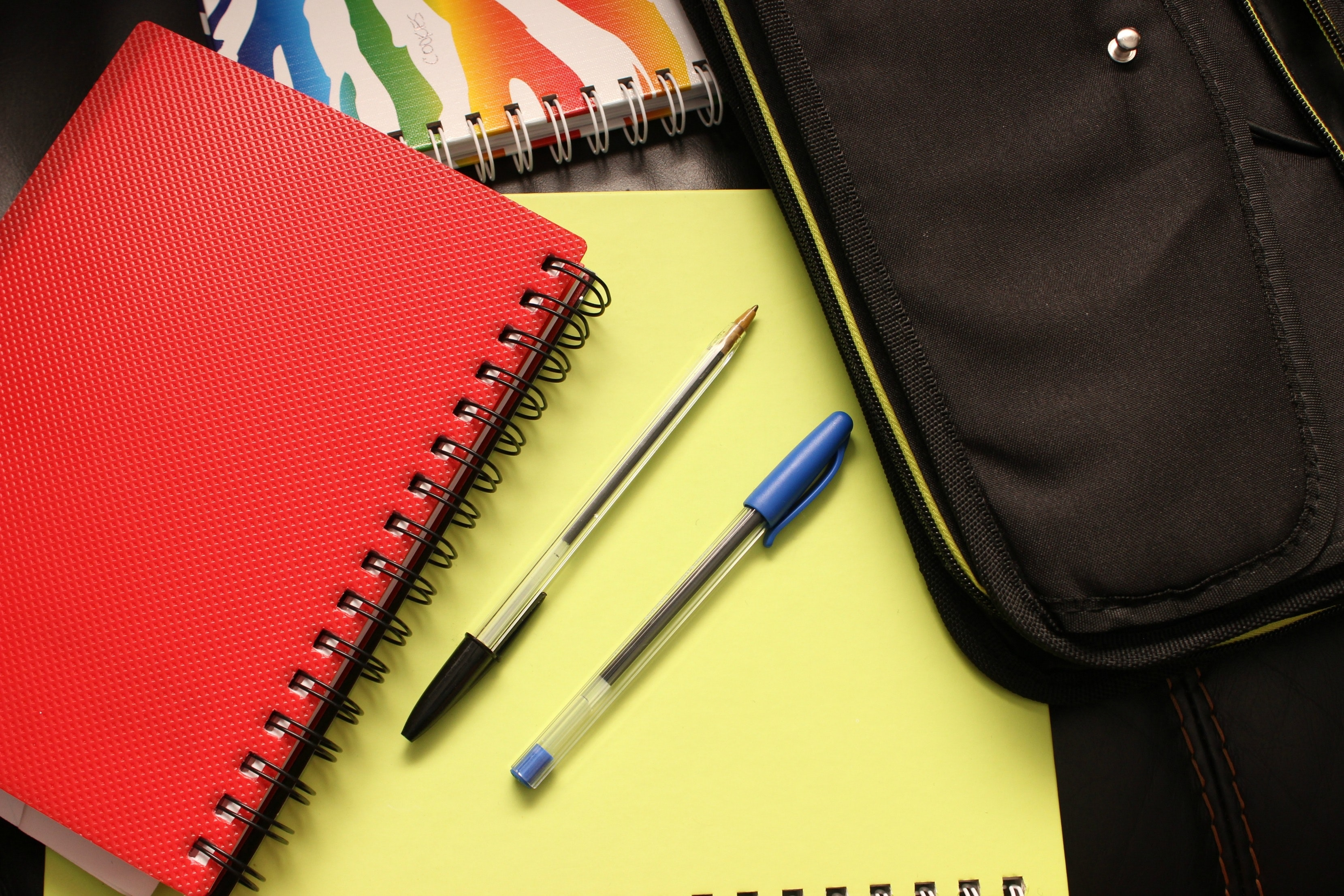 A photo of some notebooks and pens.