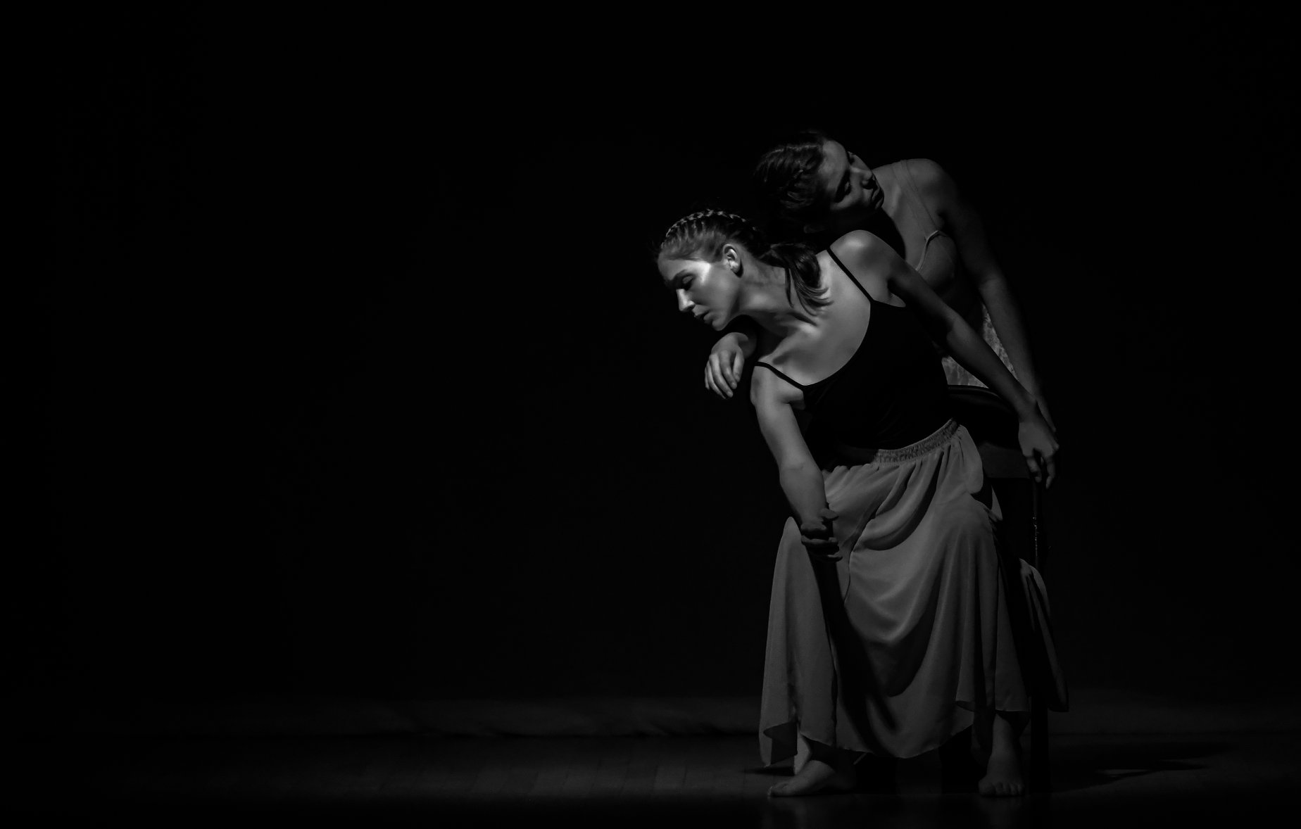 A monochromatic photo with two dancers performing