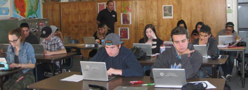 A photo of all of the students working on their computers during class