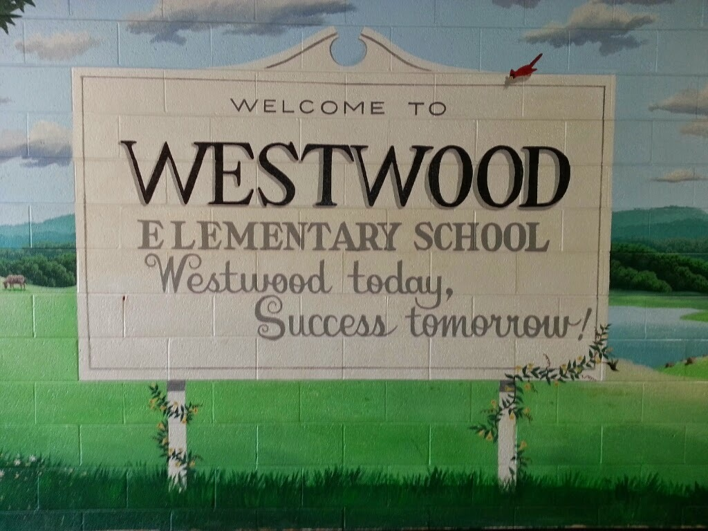 """Mural painted on wall stating, """"Welcome to Westwood Elementary School. Westwood today, Success tomorrow!"""""""