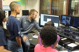 A teacher working on their virtual program