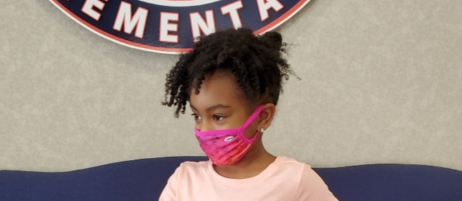 student in pink mask