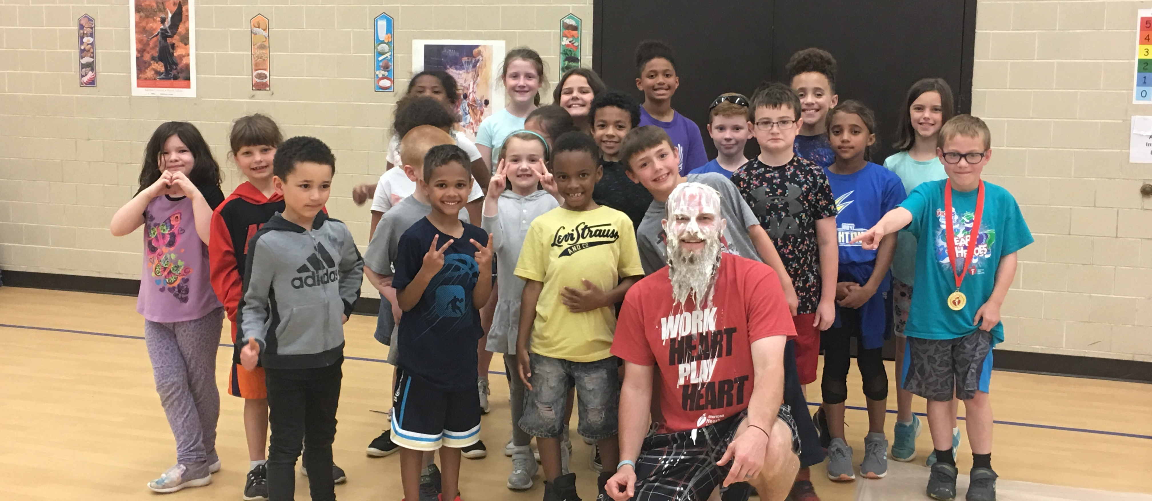 students around teacher that just got a pie in the face