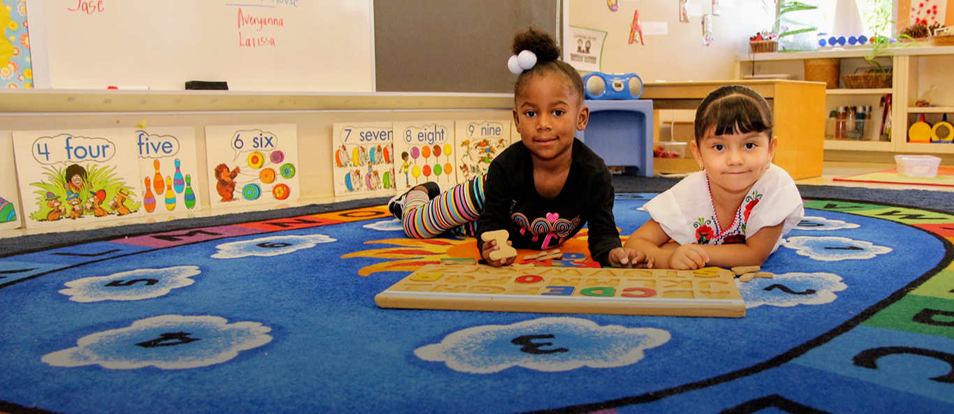 preschoolers playing with alphabet puzzle