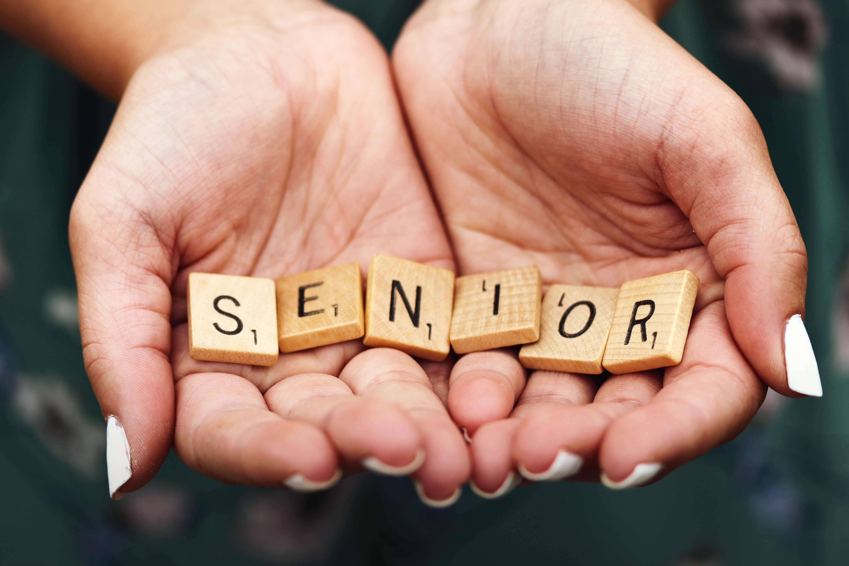Hands holding blocks of letters that spell Seniors