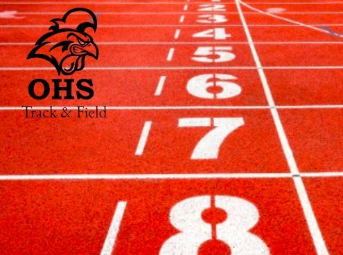 Photo of a red track field along with the school's logo