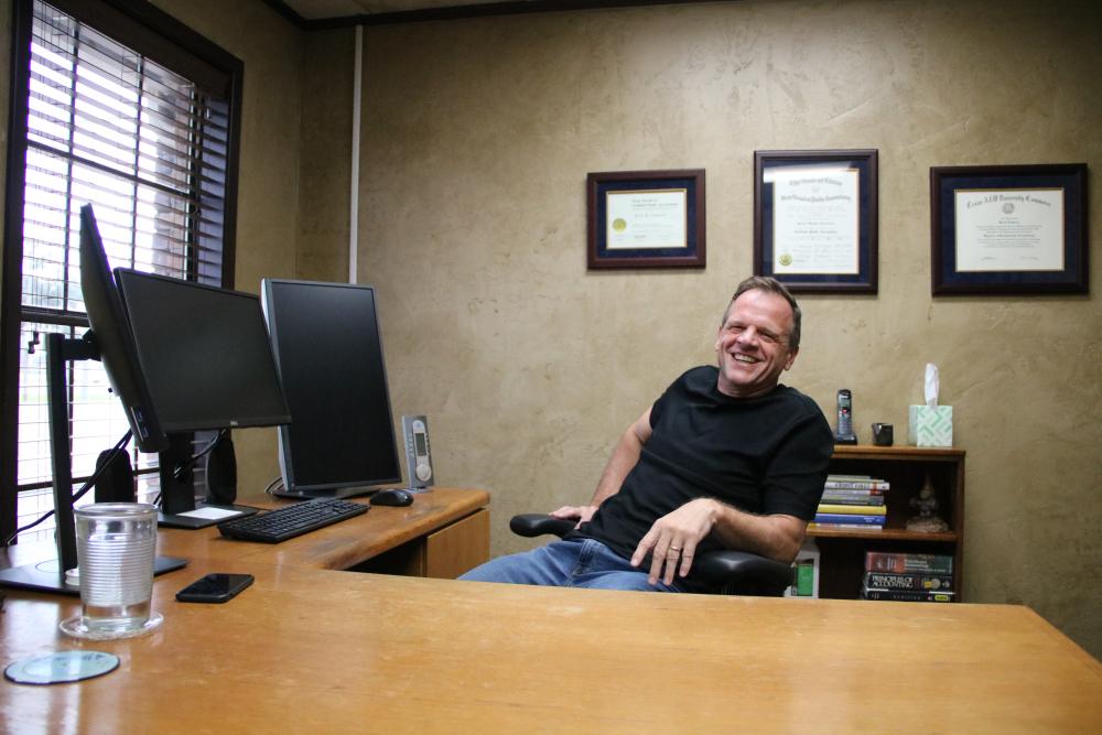 Kevin Cameron Sitting at desk