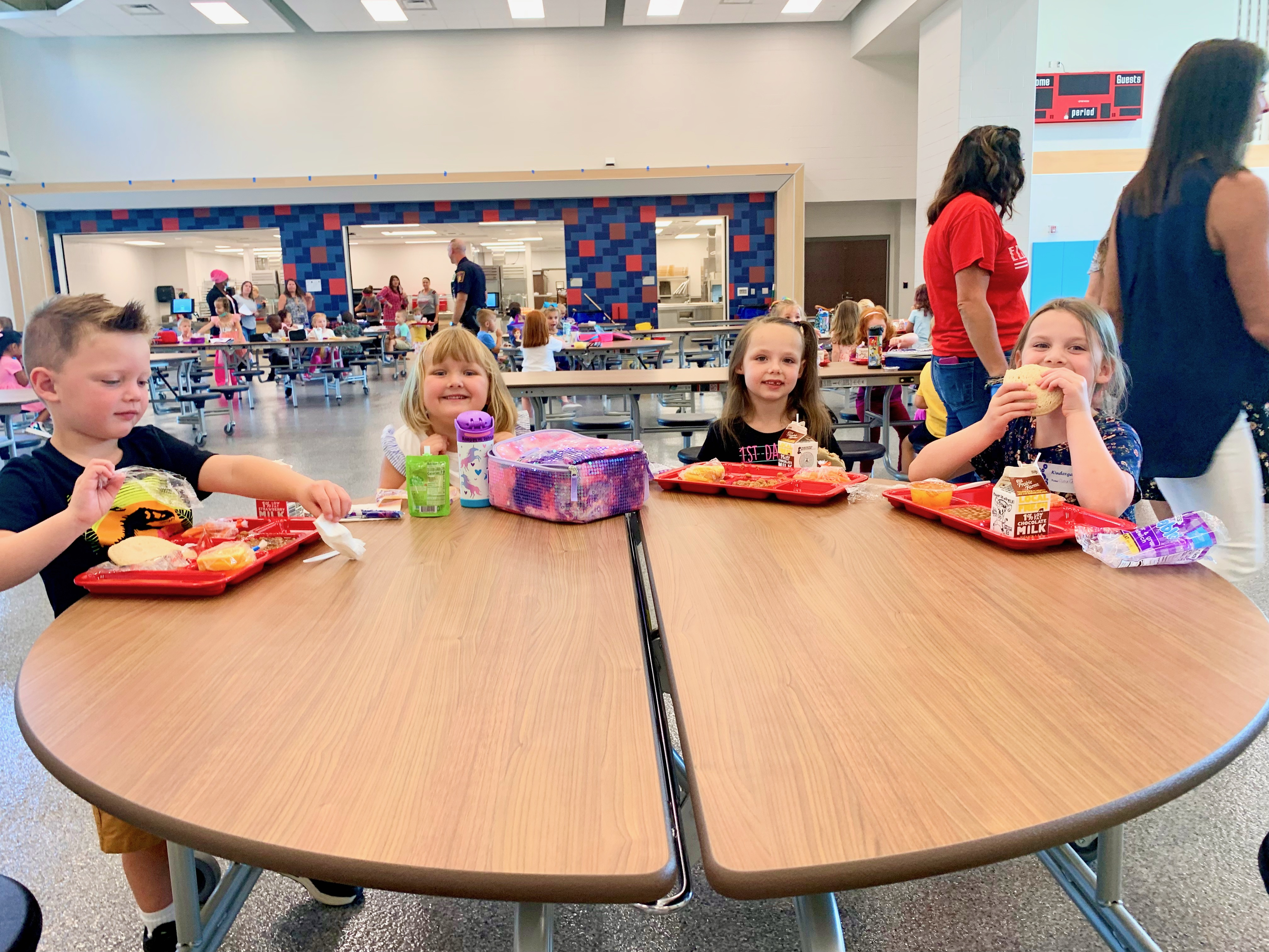 Kindergarten students loving their first lunch of the school year