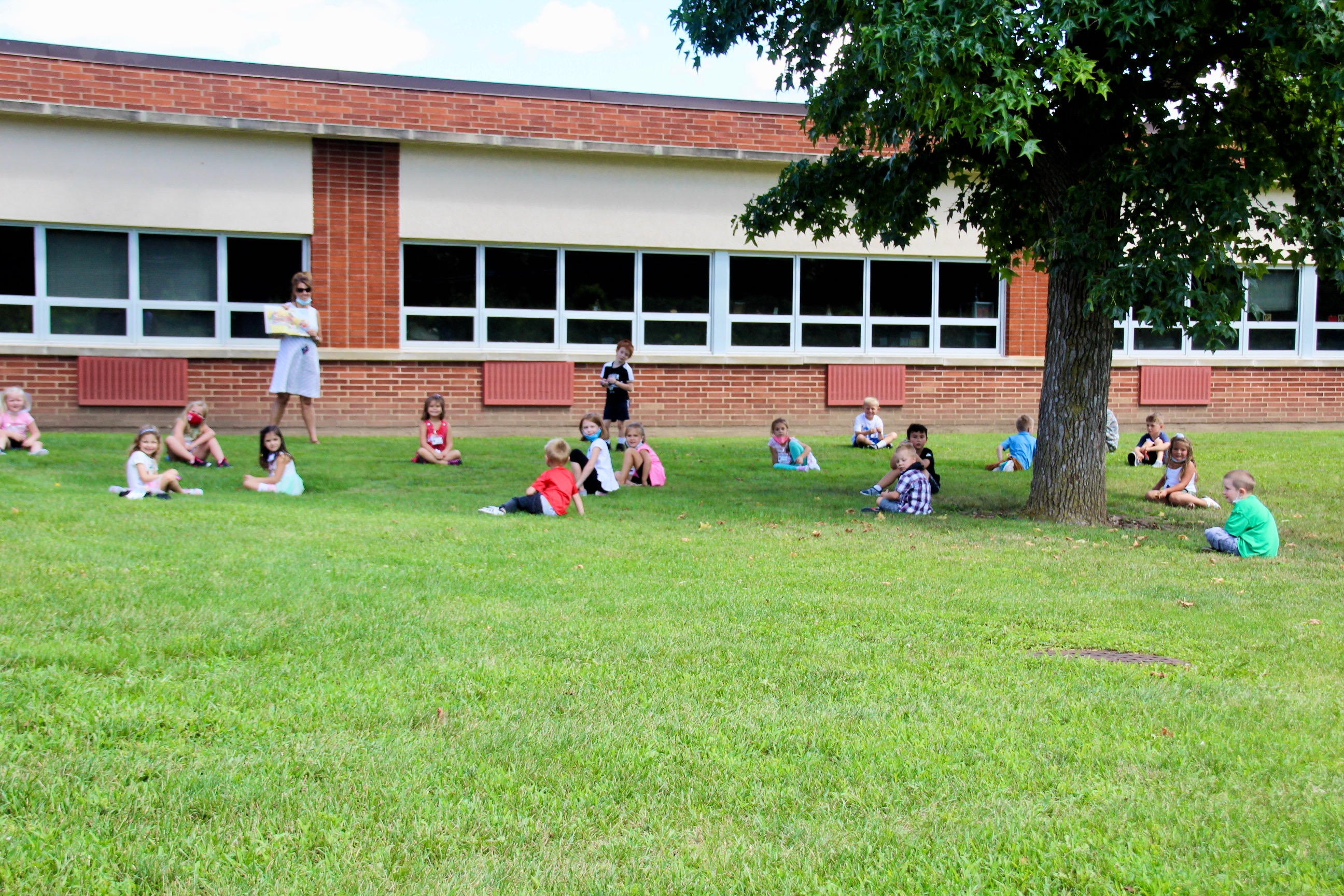 Story time gets even better when enjoyed outdoors on a perfect summer day!