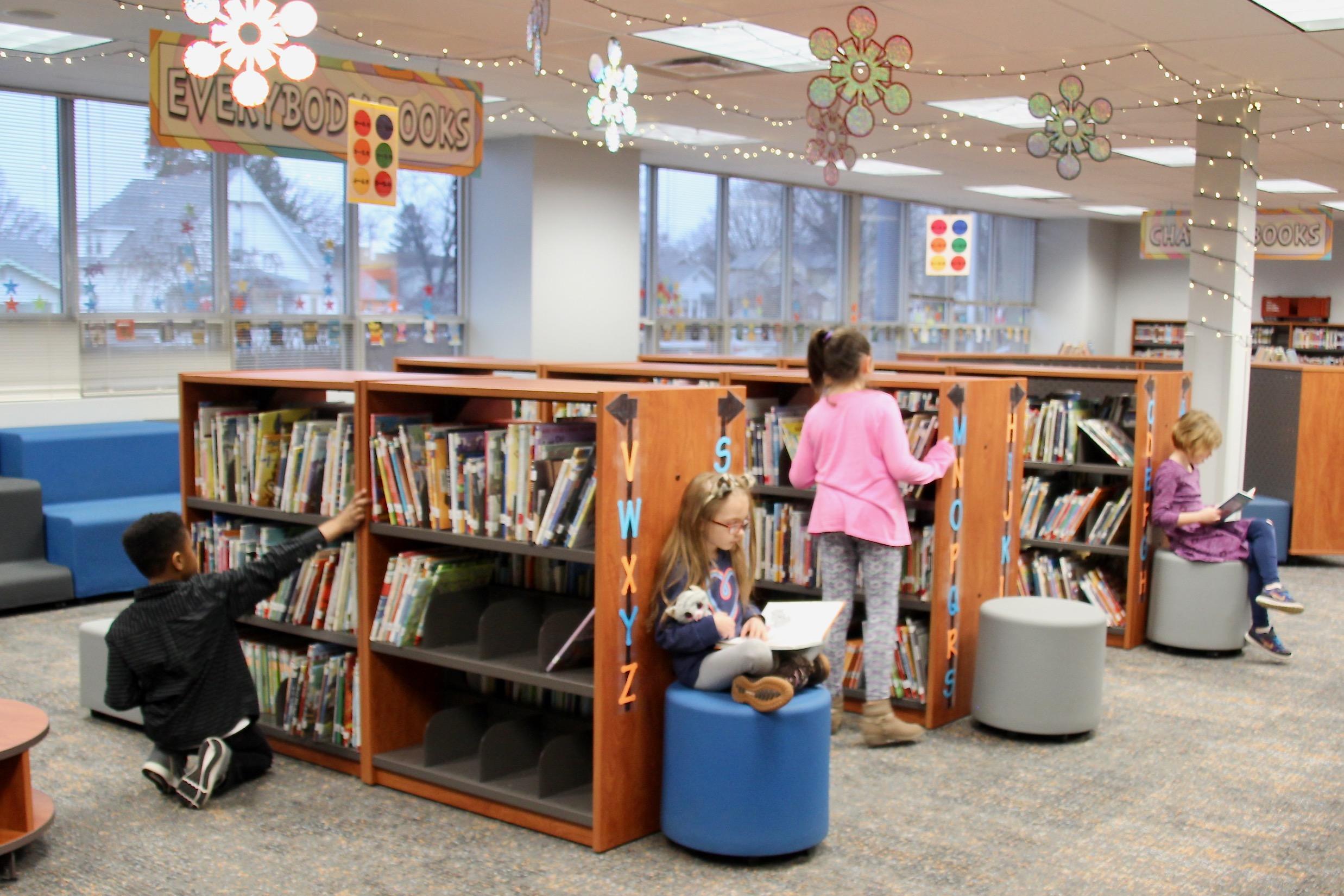 Photo of students reading books in the Van Buren Media Center