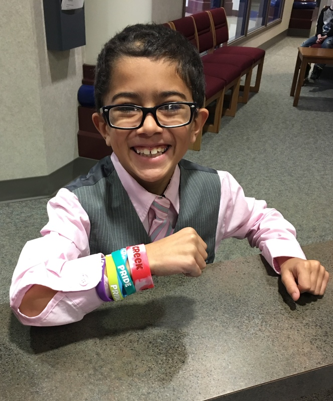 photo of student with multiple bracelets on