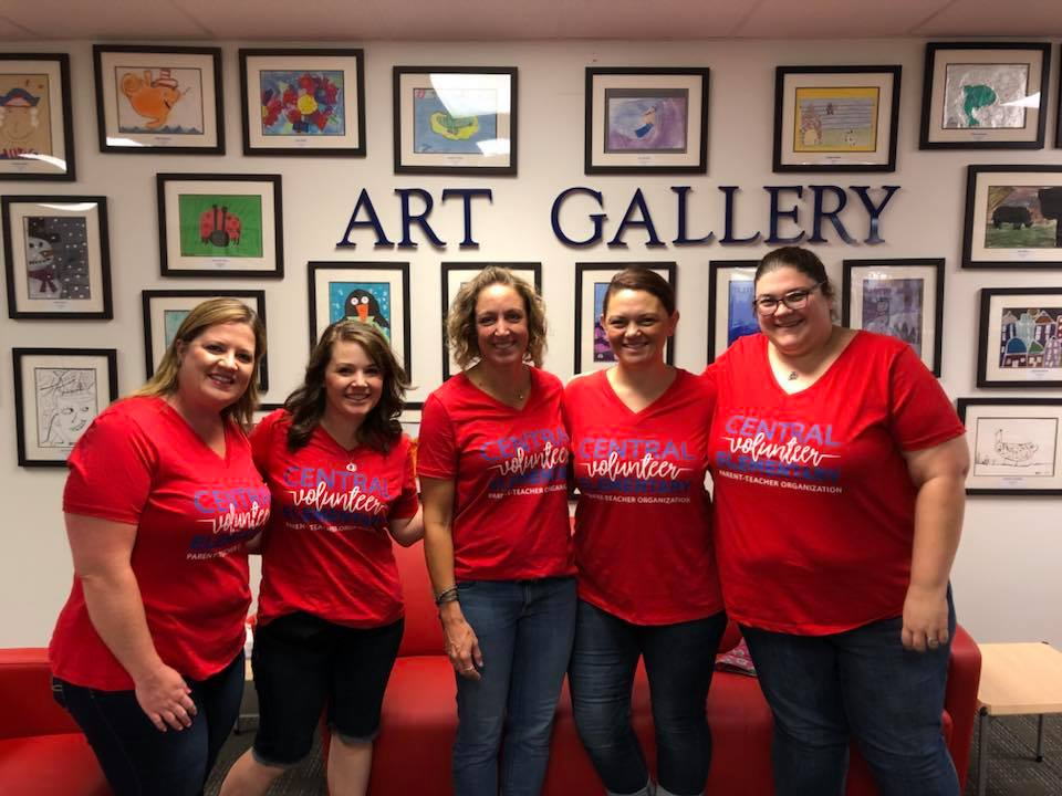 photo of volunteers in front of the student art gallery