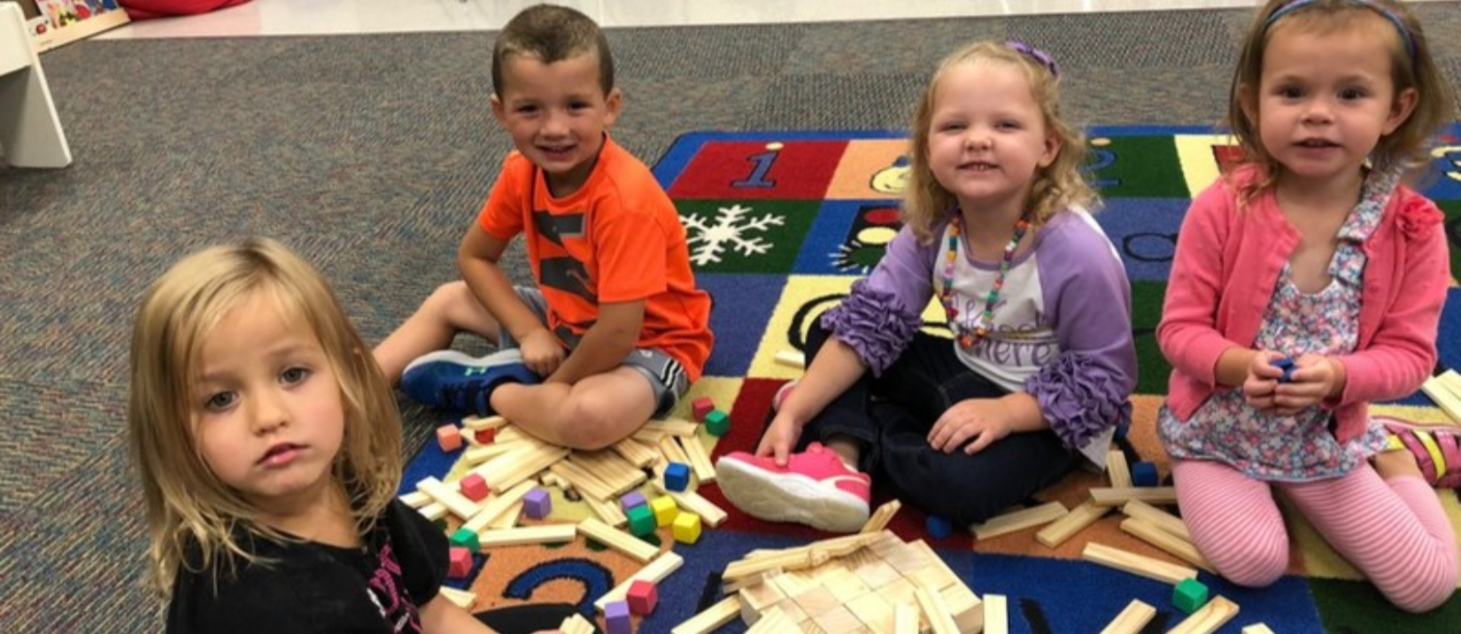 photo of students playing with blocks