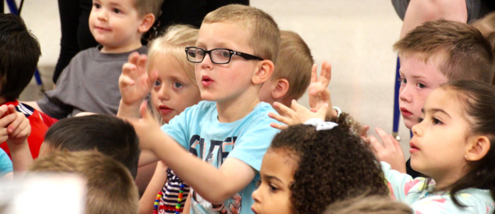 photo of students doing hand motions